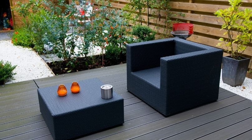 Grey garden with furniture